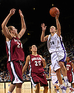 Kansas State guard Claire Coggins (14) drives and scores past Santa Clara's Anna Martin (25) and KaseyMonteith (24) in the second half at Bramlage Coliseum in Manhattan, Kansas, December 15, 2006.  K-State defeated Santa Clara 76-52.<br />
