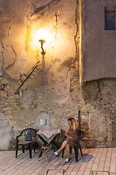 THEMENBILD - URLAUB IN KROATIEN, eine Frau sitzt an einem Tisch an der Einkaufsstrasse, aufgenommen am 03.07.2014 in Porec, Kroatien // a woman sits at a table on the main shopping street in Porec, Croatia on 2014/07/03. EXPA Pictures © 2014, PhotoCredit: EXPA/ JFK