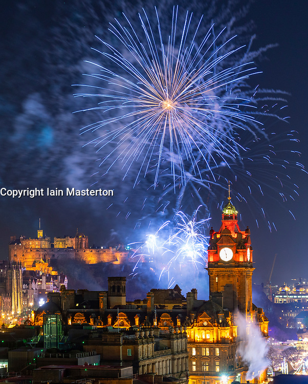 Edinburgh, Scotland, UK. 31st Dec 2019. Fireworks display above Edinburgh Castle at the start of Edinburgh's famous Hogmanay party. Iain Masterton/Alamy Live News