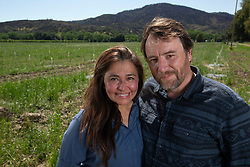 Claudia Medina, left, and Fabrice Caporal, a married couple from Alameda, Calif., are betting their retirement on a venture farming truffles on 35 acres of land in Upper Lake, Calif.; they posed for a photograph on their land Saturday, May 4, 2019. (Photo by D. Ross Cameron)