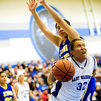 030113  Adron Gardner/Independent<br /> <br /> Navajo Pine Warrior Amanda Curley (32) drives to the basket as the Warriors battled the Zuni Thunderbirds during the 1-2A district final in Navajo March, 1.