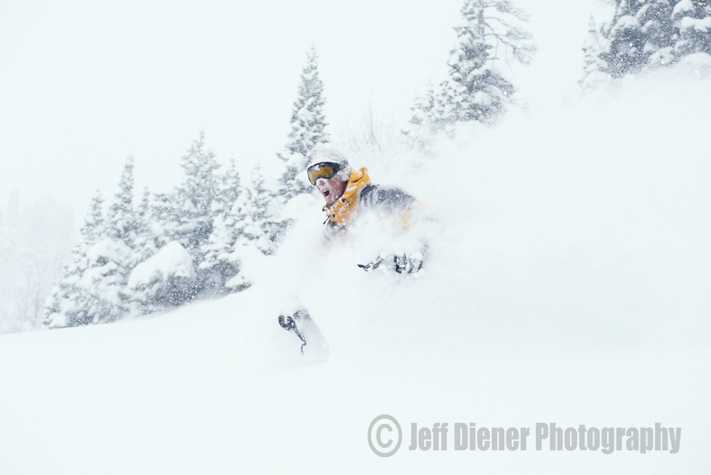 A skier gasps for air in the deep powder while backcountry skiing on Teton Pass in Jackson Hole, Wyoming.