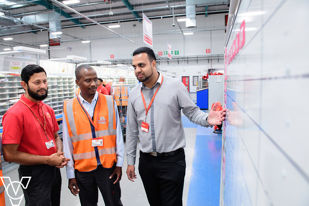 Two delivery offices, Oadby and Leicester South, which are both based inside the Leicester Mail Processing Unit building, have passed the penultimate gateway of One Plan.  One Plan is a business programme designed to have a standardised operation of excellence.  Pictured is Shahbaaz Khan, right, working with, from left, Shuaib Chowdhury and Collis Shepherd.<br /> <br /> Picture: Chris Vaughan Photography<br /> Date: July 7, 2017
