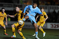 Reuben Reid of Plymouth Argyle looks to get a shot  past Newport's Darcy Blake (l).Skybet football league two match, Newport county  v Plymouth Argyle at Rodney Parade in Newport, South Wales on Tuesday 8th April 2014.<br /> pic by Andrew Orchard, Andrew Orchard sports photography.