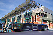 The METRO Rail train passing in front of the west wing, the latest addition to the Phoenix Convention Center, downtown Phoenix, Arizona.