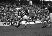 07/09/1975<br /> 09/07/1975<br /> 7 September 1975<br /> All-Ireland Hurling Final: Kilkenny v Galway at Croke Park, Dublin. <br /> Kilkenny center half-forward, Pat Delaney (11), tussels with Galway full-back, Joe Clarke for possession near the Galway line. Also in the picture is Kilkenny defender, Mick Brennan, holding off Galway's Pat Lally, while watching the outcome.