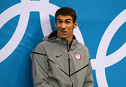 USA's Michael Phelps waits to receive his gold medal for the Men's 200m Individual Medley at the Aquatics Centre in the Olympic Park, London.
