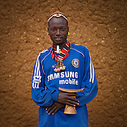 The football stars of tomorrow<br /> <br /> Thousands of Football shirts of Arsenal, Manchester, Chelsea, Milano, etc end up their carreer in... Ethiopia. Sold in the deep south, in the Omo Valley, those second hand clothes are bought by the local tribes. Most of them ignore the meaning of those shirts, and just buy them for the color, the logo, or the shape.<br /> No warrior will go out without his little pillow/seat.<br /> Some, like in Hamer tribe wear at the top of the head a clay helmet where they can put some ostrich feathers when they make a special action, like killing a wild animal, or...a man.<br /> Those tribes won't exist in few years as the ethiopian governement has launched a huge plan to develop the area.<br /> Soon, a highway coming from Mombassa - Nairobi will pass thru the villages to reach Addis Ababa.<br /> <br /> Photo shows: Hamar in Turmi, Ethiopia. He wears a Chelsea shirt because all the men who can access to a Tv in villages love football!<br /> ©Eric Lafforgue/Exclusivepix Media