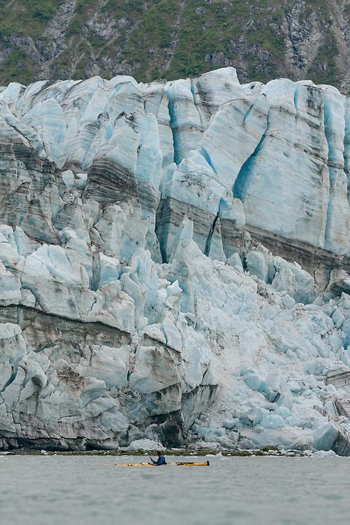 Kayaker paddling near Lamplugh Glacier in Alaska's Glacier Bay National Park and Preserve. Photo © Robert Zaleski / rzcreative.com<br /> —<br /> To license this image contact: robert@rzcreative.com