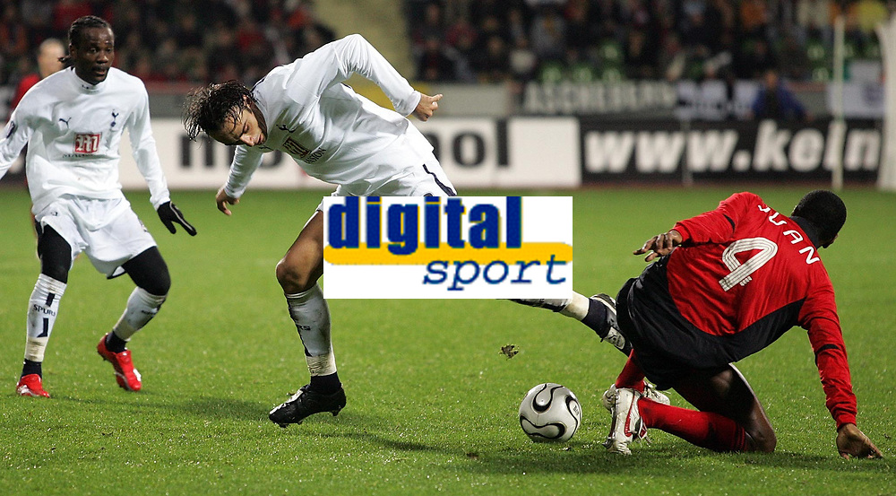Photo: Paul Thomas.<br /> Bayer Leverkusen v Tottenham Hotspur. UEFA Cup. 23/11/2006.<br /> <br /> Goal scorer Dimitar Berbatov (9) of Spurs tries to win the ball from Juan.