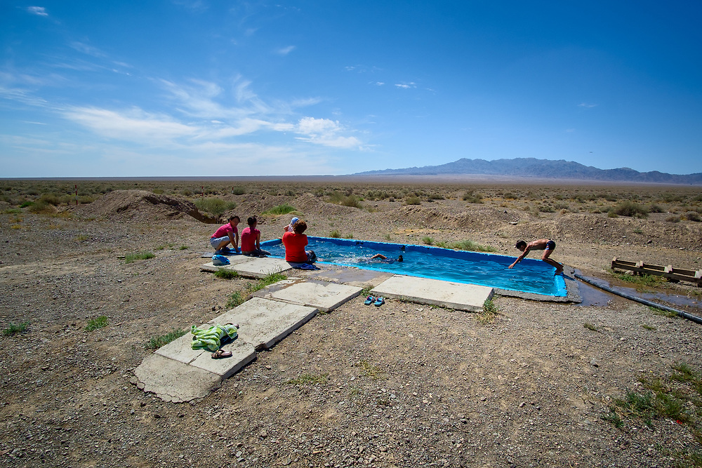 A local ranger that I stayed with during one of my trips built this swimming pool for his family in a middle of a desert. The water for the pool comes from an underground natural spring and helps the family cope with the hot sunny Summer days, when the temperatures are as high as 50C (122F).