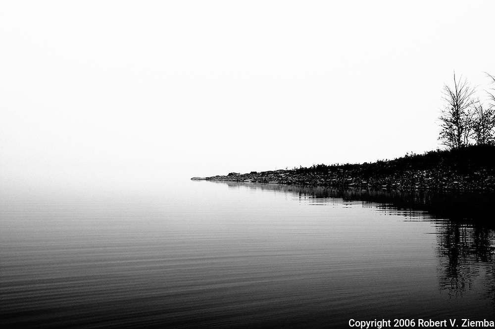 A minimal black and white image of Miller Hollow Point jutting out into the Pepacton Reservoir.