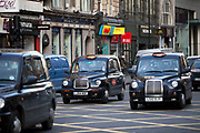 London black taxi cabs at Holborn, London. Motorised hackney cabs in the UK, traditionally all black in London and most major cities, are traditionally known as black cabs (which they were), although they are now produced in a variety of colours.