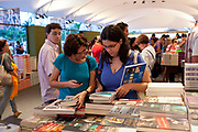 A woman browses through books at the annual FLIP literary event in Paraty, Rio de Janeiro, Brazil.