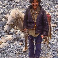 A horseman below the Thorang La pass in Nepal's Annapurna region.