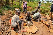 Gold mine in South Kivu, DRC Congo. Young miners at a processing site where they break and ground down gold ore, mix it with water,  and extract the gold. Murale, South Kivu, DRC.  August 2010.<br /> Des mineurs jeunes travailent sur un site de traitement proche d une mine d or ou ils ecrasent et broyent le minerai d or, le melangent avec de l eau  pour en extraire l or.  Murale, Sud-Kivu, RDC. Aout 2010.