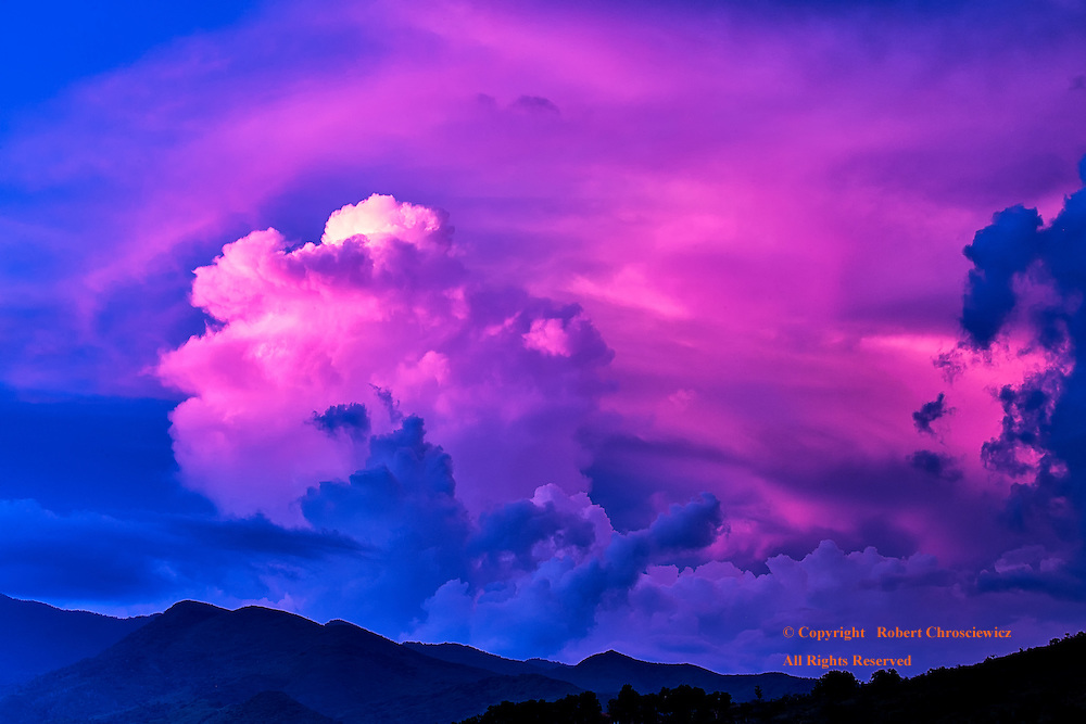 Pink Over Trinidad: Sunset settles into a glorious pink display, set against the blue silhouetted mountains of Trinidad Cuba.