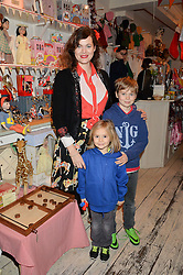 JASMINE GUINNESS and her children OTIS RAINEY and RUBY RAINEY at a promotional party for the A Girl For All Time doll held at HoneyJam, 2 Blenheim Crescent, London on 5th December 2015.