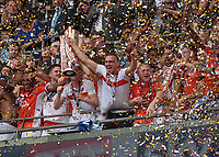 Football - 2017 Sky Bet [EFL] League Two Play-Off Final - Blackpool vs. Exeter City<br /> <br /> Tom Aldred of Blackpool  lifts the Play Off trophy amongst the confetti at Wembley.<br /> <br /> COLORSPORT/DANIEL BEARHAM