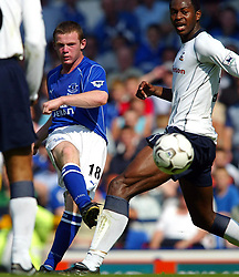 File photo dated 17-08-2002 of Everton's 16-year-old Wayne Rooney (left) tries a shot, past Tottenham Hotspur's Anthony Gardner, as he makes his debut during their FA Barclaycard Premiership match at Everton's Goodison Park ground in Liverpool.