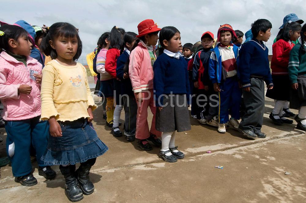 El Alto primary school. Assembly. Pupils line up.