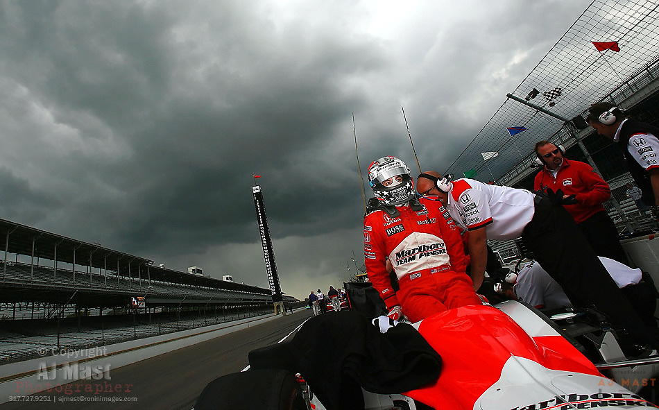 Indy Racing League driver Sam Hornish Jr. climbs into his car as storm clouds move in to end practice for the 90th running of the Indianapolis 500 at the Indianapolis Motor Speedway Thursday, May 18, 2006 in Indianapolis.  (AP Photo/AJ Mast)
