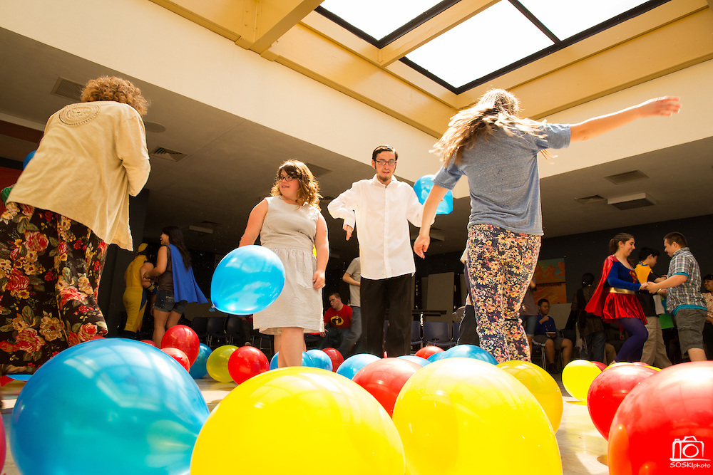 From left to right, Prospect High School Special Education students Alexis Johnson, 17,  Jonathan Hjeltness, 17, and Bylee Peterson, 16, dance during the Santa Clara County Super Hero Dance for Special Education students at Milpitas High School in Milpitas, California, on April 18, 2014. (Stan Olszewski/SOSKIphoto)