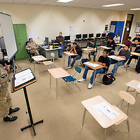 101713       Brian Leddy<br /> Manuel Shirleson speaks to a group of students at Tohatchi High School Thursday. Students at the school listened to several veterans talk about their military service as part of a career day function.