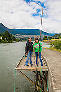 Sisters Kim Brigham Campbell and Terrie Brigham fishing from one of their traditional platforms on the Columbia River at Cascade Locks, Oregon