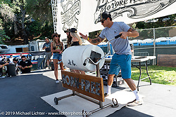 Event promoter Mike Davis mixes the giant tumbler for the raffle bike at the Born-Free Vintage Motorcycle show at Oak Canyon Ranch, Silverado, CA, USA. Sunday, June 23, 2019. Photography ©2019 Michael Lichter.