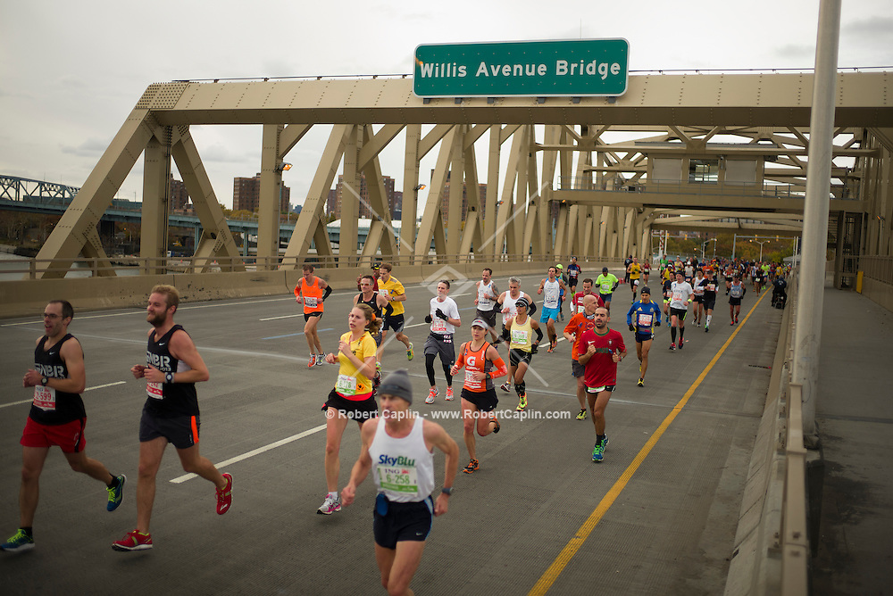 New York, New York - November 1, 2013 - Marathon runners cross the Willis Avenue Bridge in The Bronx. <br /> <br /> Credit: Photo by Robert Caplin
