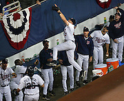 Minnesota  Twins Third baseman Corey Koski leaps above the dugout in an attempt to make a catch during the eighth inning of the Twins victory over the Anaheim Angels with a score of 2-1  Tuesday night at the Metrodome during the first game of the American League Championship Series. ..