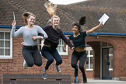 © Licensed to London News Pictures. 13/08/2015. Solihull, West Midlands, UK. A level results day at Solihull School. A record breaking year for the school as it had 88% of students with A Star to B passes. Pictured, from left, Alex Levey, Annie Bewick and Muskan Shrivastava. Photo credit : Dave Warren/LNP