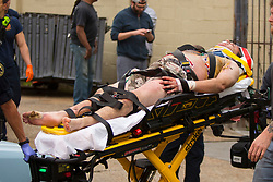 EXCLUSIVE: Crew member for Motley Crue movie 'The Dirt' is rushed to hospital after being electrocuted while working on the rooftop of the set in New Orleans. The man had be be lowered in a crane by ambulance workers. visible signs of electricity burns could be seen on his foot and chest. His current condition is unknown. The members of Motley Crue are all co-producers for the movie. ( Vince Neil, Tommy Lee, Mick Mark, Nikki Sixx). 10 Mar 2018 Pictured: EMS attends to 'The Dirt' Motley Crue movie crew member. Photo credit: MEGA TheMegaAgency.com +1 888 505 6342