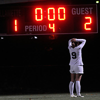 Bend's Cambria Hurd (9) stares at the scoreboard after loosing to Summit in the Class 5A State Championship match at Sparks Field in Salem on Tuesday.