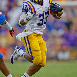 Oct 12, 2013; Baton Rouge, LA, USA; LSU Tigers running back Jeremy Hill (33) against the Florida Gators during the second half of a game at Tiger Stadium. LSU defeated Florida 17-6. Mandatory Credit: Derick E. Hingle-USA TODAY Sports
