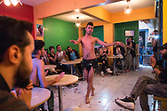 A dancer at a same-sex Syrian engagement party the My Dubai Cafe in the city, before an audience of other LGBT refugees from Syria and Iraq. Muhammed Wisam Sankari, also a gay Syrian man (wearing a black baseball cap at rear) was recently murdered in Istanbul and reportedly beheaded in a homophobic attack