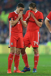 14th November 2017 - International Friendly - Wales v Panama - James Chester of Wales (L) and teammate David Edwards cover their mouths as they discuss tactics - Photo: Simon Stacpoole / Offside.