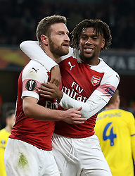 Arsenal's Shkodran Mustafi (left) celebrates his side's second goal of the game with team mate Alex Iwobi