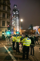 © Licensed to London News Pictures. 31/12/2018. London, UK. Police guard the entrance to Whitehall - in sight of a scaffold clad Big Ben - before the crowds arrive to celebrate New Year's Eve in central London.  Over 100,000 people are attending London's ticketed fireworks display on the banks of the River Thames for New Year's Eve tonight. Photo credit: Peter Macdiarmid/LNP