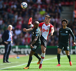 Dusan Tadic of Southampton battles for the ball with Fabian Delph of Manchester City - Mandatory by-line: Alex James/JMP - 13/05/2018 - FOOTBALL - St Mary's Stadium - Southampton, England - Southampton v Manchester City - Premier League
