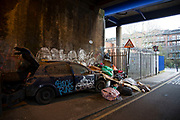Fly tipping site under railway arches in East London, England, United Kingdom. Illegal dumping, also called fly dumping or fly tipping, is the dumping of waste illegally instead of using an authorised method such as kerbside collection or using an authorised rubbish dump. It is the illegal deposit of any waste onto land, including waste dumped or tipped on a site with no licence to accept waste.