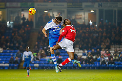 Christian Burgess of Peterborough United and Kieran Agard of Bristol City compete in the air - Photo mandatory by-line: Rogan Thomson/JMP - 07966 386802 - 28/11/2014 - SPORT - FOOTBALL - Peterborough, England - ABAX Stadium - Peterborough United v Bristol City - Sky Bet League 1.