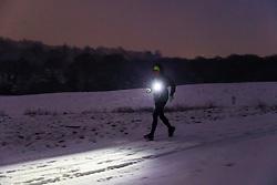 A runner makes his way across Hampstead Heath as snowfall on higher ground in London creates a wintery landscape. Hampstead, London, February 01 2019.