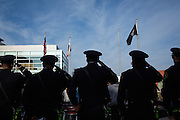 The Milpitas Fire Department stands attention during the Presentation of the Colors and Flag Raising by the Knights of Columbus – 4th Degree during the Veterans Day Ceremony at Milpitas City Hall's Veterans Plaza in Milpitas, California, on November 11, 2013. (Stan Olszewski/SOSKIphoto)