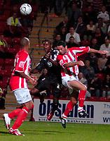 Photo: Ed Godden.<br /> Cheltenham Town v Bristol City. Carling Cup. 22/08/2006.<br /> Jennison Williams (C) rises high for Bristol City.