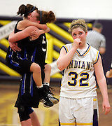 SCOTT MORGAN | ROCKFORD REGISTER STAR.Hononegah High School's Courtney Shelton (32) looks at the clock as St. Charles North players celebrate their win Thursday, Feb. 21, 2008 in the Class 4A Sectional at Hononegah High School in Rockton.