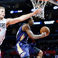 27 November 2015: New Orleans Pelicans guard Ish Smith (4) goes for the reverse layup past Los Angeles Clippers forward Blake Griffin (32) during the Los Angeles Clippers 111-90 victory over the New Orleans Pelicans, at the Staples Center, Los Angeles, California, USA.
