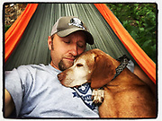 SHOT 8/2/16 11:36:41 AM - Marc Piscotty of Denver, Co. snuggles with his dog Tanner, a 12 year old male Vizsla, while camping in Colorado. (Photo by Marc Piscotty / © 2017)