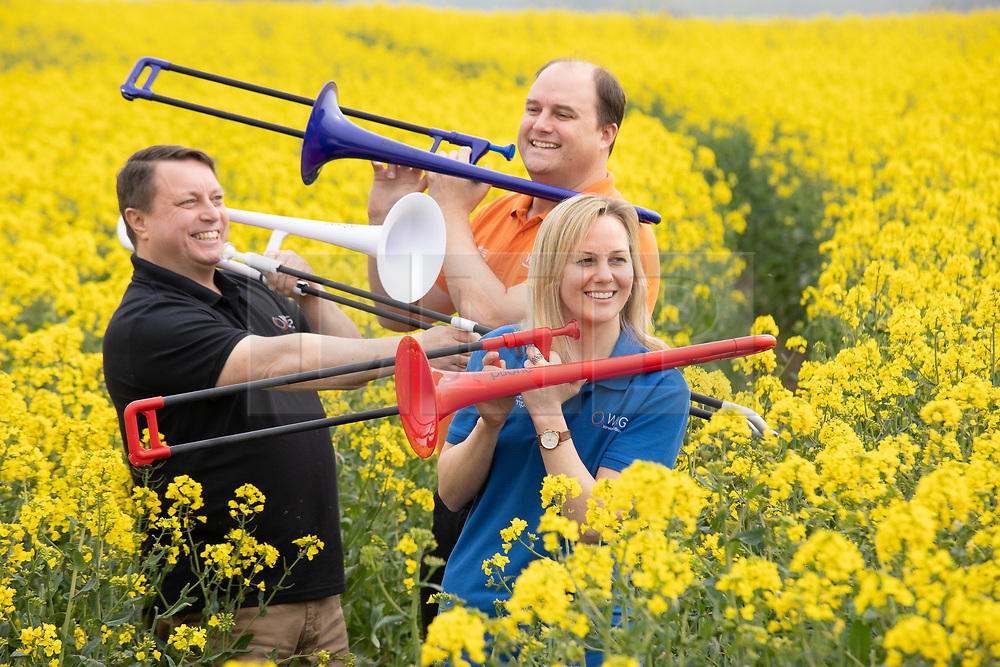 © Licensed to London News Pictures. 22/04/2019.Tamworth, Staffordshire, UK. STRICT EMBARGO: NOT TO BE PUBLISHED OR BROADCAST BEFORE 1 AM TUESDAY 23 APRIL 2019. Pictured from (left to right) Chris Fower, Steven Greenall and Lucy Leddington Wright of Warwick Music Group. Created by a team of British musicians, pBone - the world's first plastic trombone which has become the world's best-selling trombone – has been awarded The Queen's Award for Enterprise for its innovation. More than 250,000 pBones have been sold resulting in a 15% increase in trombone sales worldwide according to music industry experts. In just five years, Warwick Music Group's team of musicians, entrepreneurs and enthusiasts became world-leaders and the dominant manufacturer of brass instruments created in recyclable ABS plastic. Their innovative approach has radically changed a sector of the music market that has experienced little change for two centuries.<br /> Based in West Midlands, England, Warwick Music Group (WMG) now spans four continents: North America, Europe, Asia and Oceania (Australia). <br /> Photo credit: Dave Warren/LNP